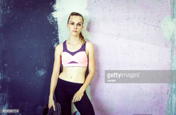 Portrait of Female Athlete Leaning on Wall