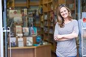 Portrait Of Female Bookshop Owner Outside Store