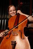 Portrait of female cellist smiling