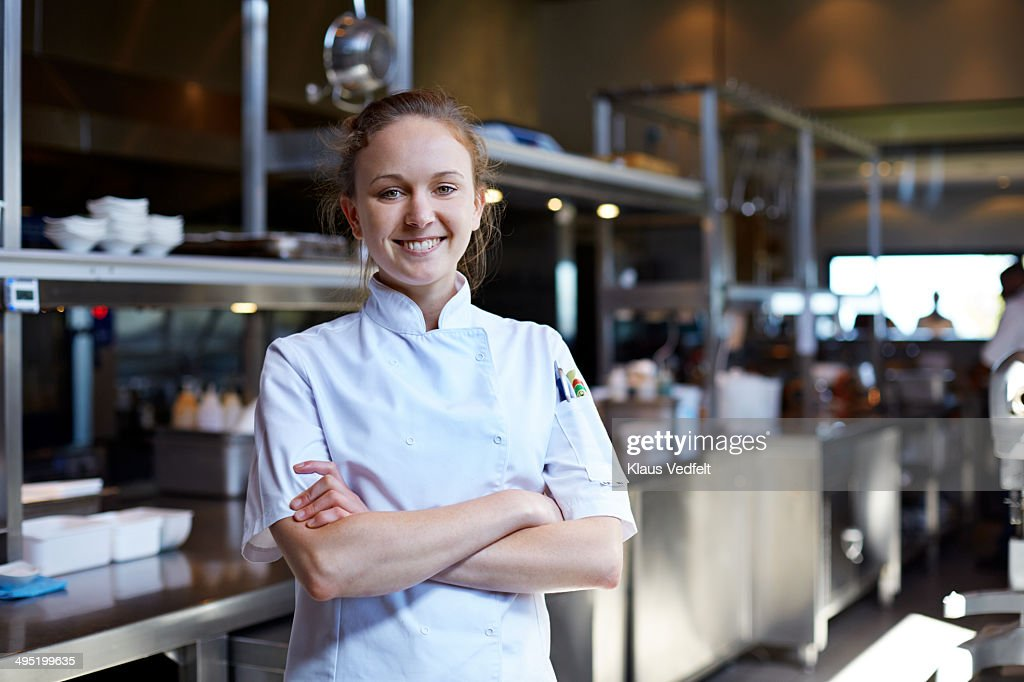 Portrait of female chef at restaurant