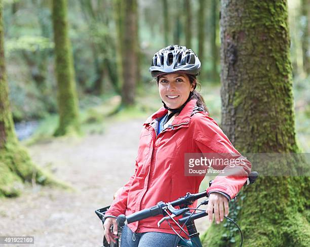 Portrait of female cyclist smiling.