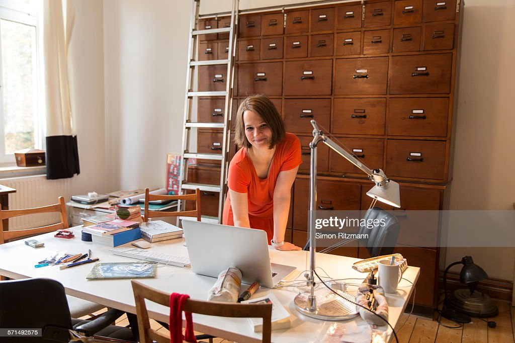 Portrait of female designer in home office. : Stock Photo