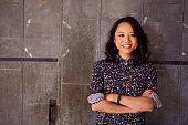 Portrait Of Female Designer Standing In Modern Office