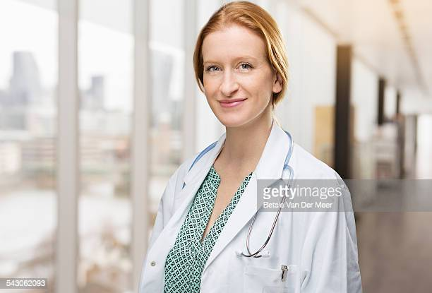 Portrait of female doctor in corridor in hospital.