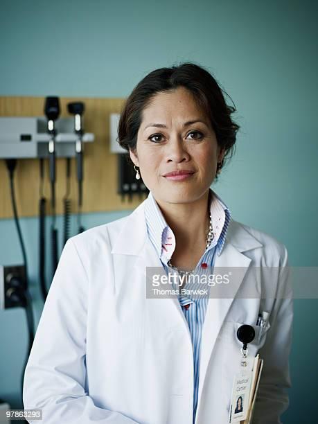 Portrait of female doctor in exam room