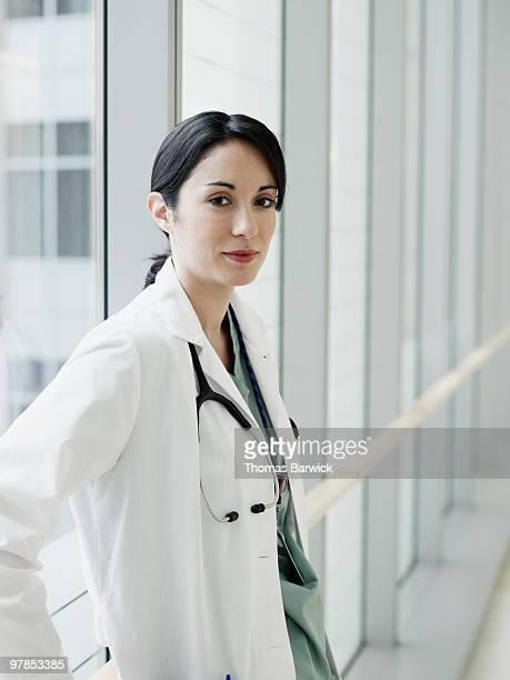 Portrait of female doctor in hospital corridor
