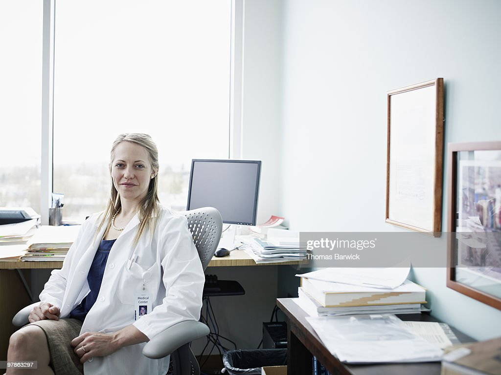 Portrait of female doctor in office : Stock Photo