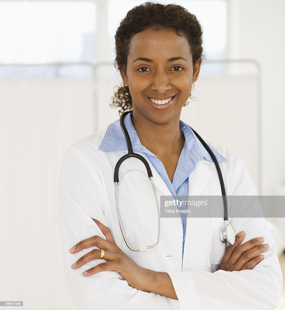 Portrait of female doctor with arms crossed : Stock Photo