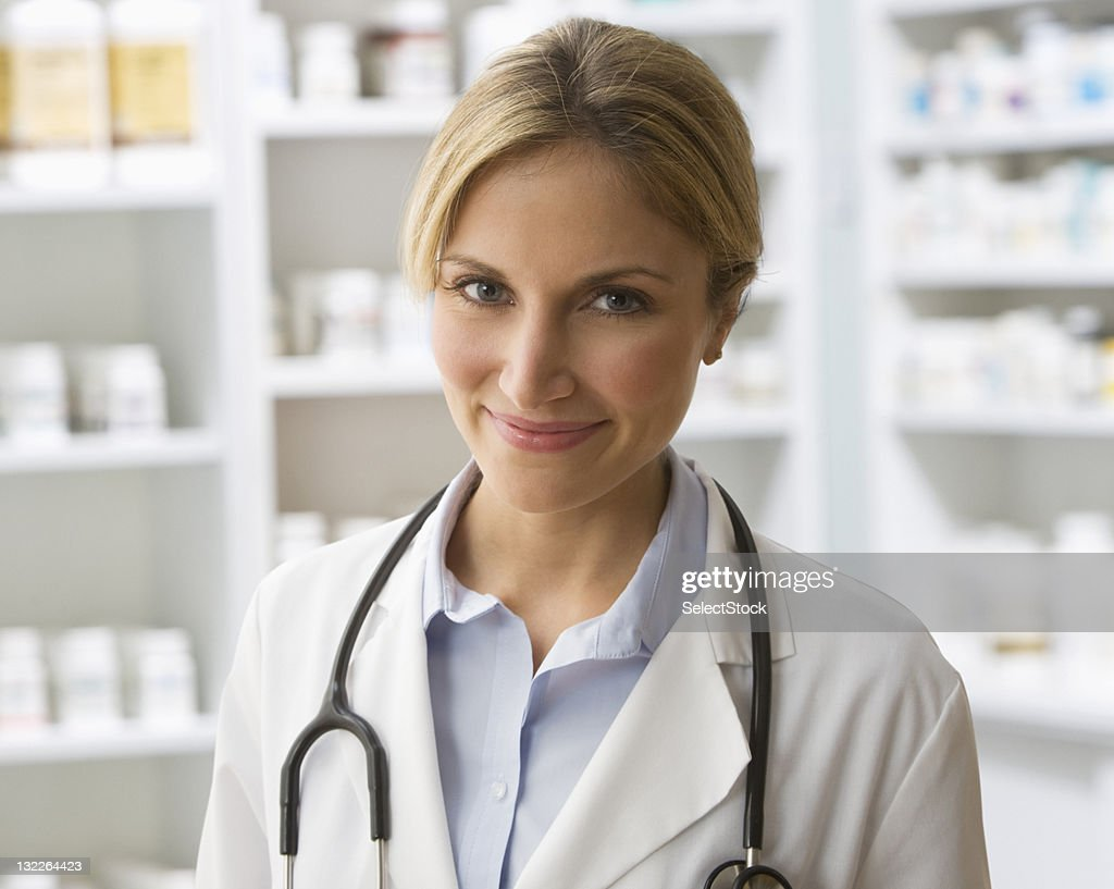 Portrait of female doctor with stethoscope : Stock Photo