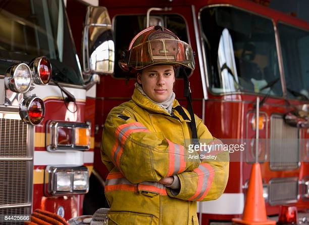 Portrait of Female Fire Fighter in Fire Station