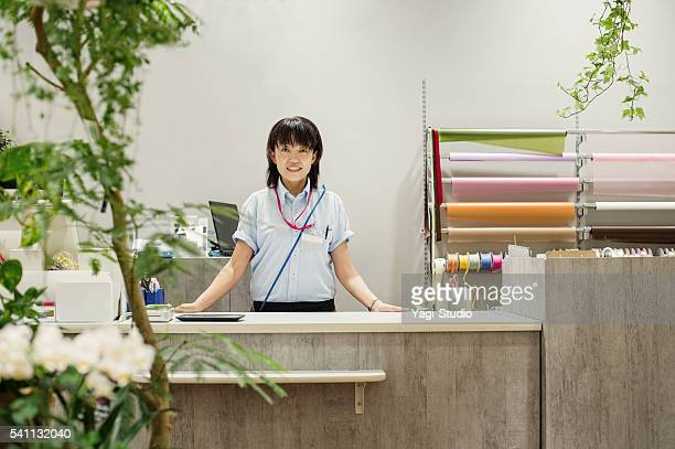 Portrait Of Female Florist in flower shop