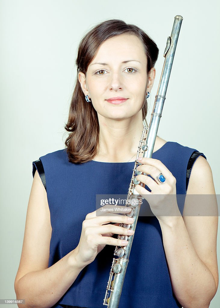 Portrait of Female Flute Player