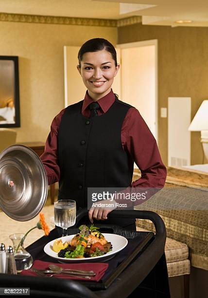 Portrait of female hotel staff with room service