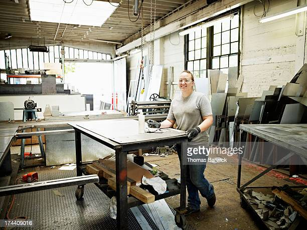 Portrait of female metal worker in metal shop