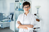 Portrait of female optometrist at eyesight medical ophthalmology clinic