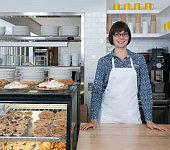 Portrait of female owner in bakery
