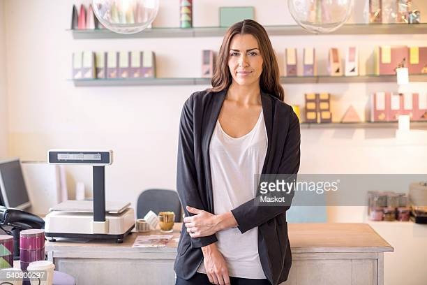 Portrait of Female owner standing in candy store