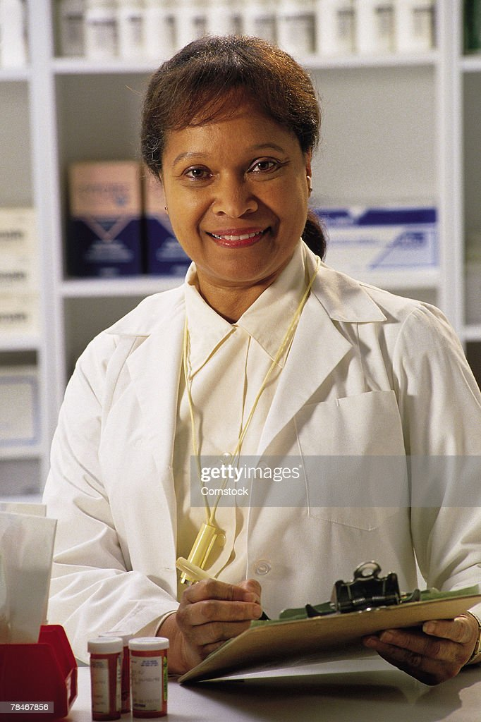Portrait of female pharmacist : Stock Photo