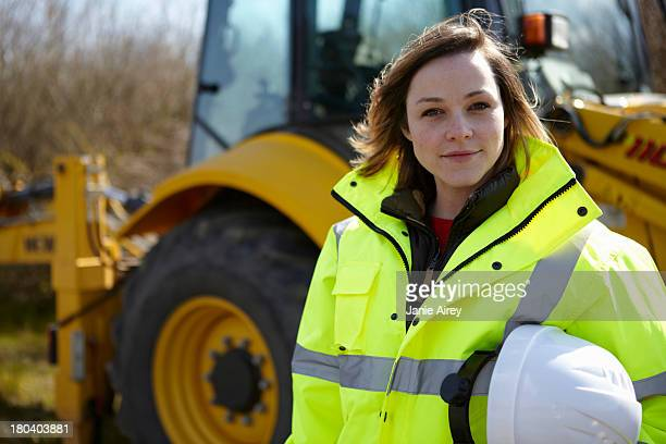 Portrait of female project manager on construction site