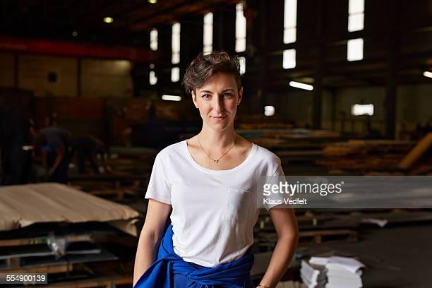 Portrait of female steel worker inside factory