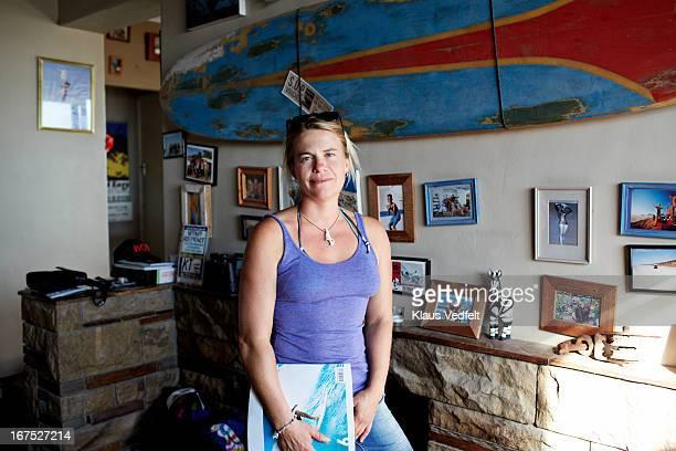 Portrait of female surfer in her livingroom