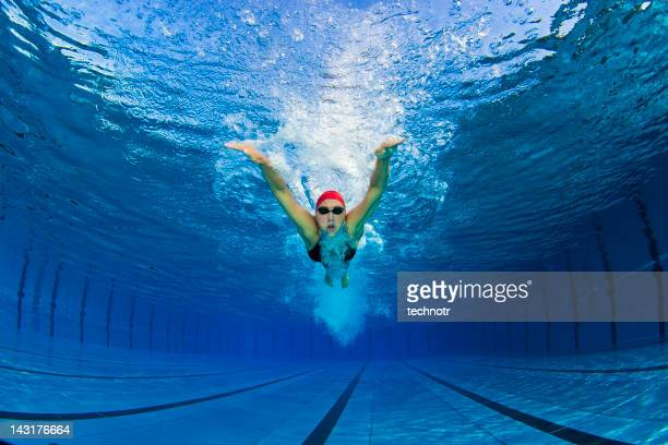 Portrait of female swimmer at butterfly stroke