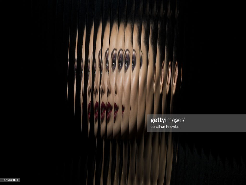 Portrait of female through glass