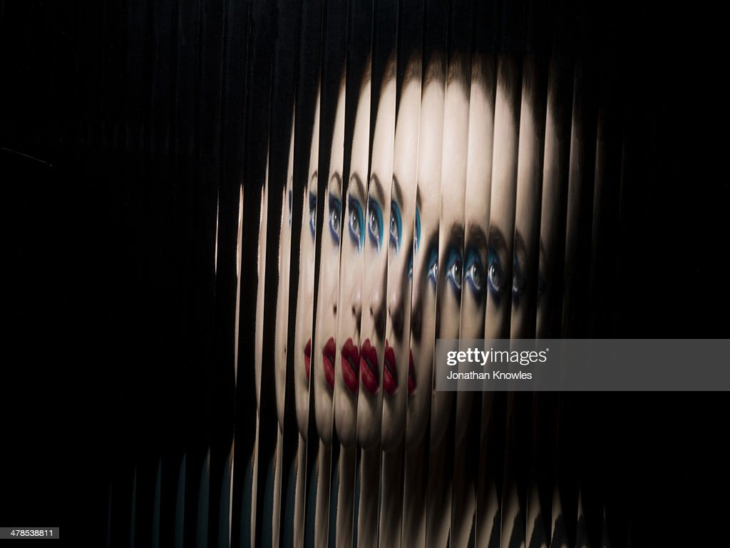 Portrait of female through glass : Stock Photo