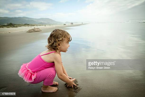 Portrait of female toddler playing in sand