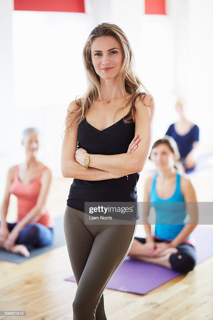 Portrait of female tutor in pilates class