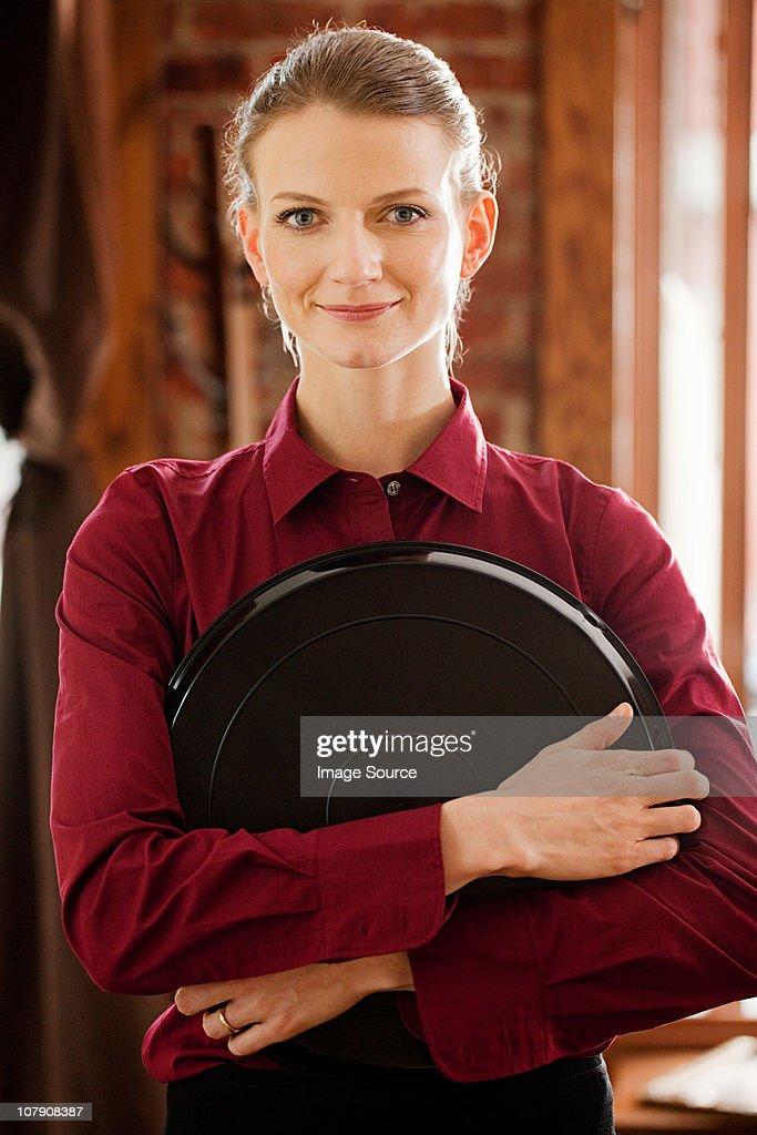 Portrait of female waitress : Stock Photo
