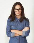 Portrait of female wearing glasses, crossed armed