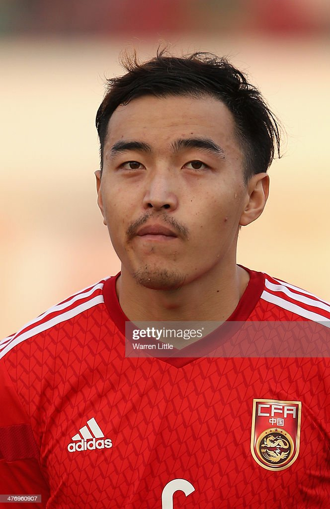 A portrait of Feng Xiaoting of China during the Asian Cup Qualification match between China and Iraq at the Al-Sharjah Stadium on March 5, 2014 in Sharjah, United Arab Emirates.