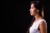 Studio Shot Of Woman From Philippines Against Black Background