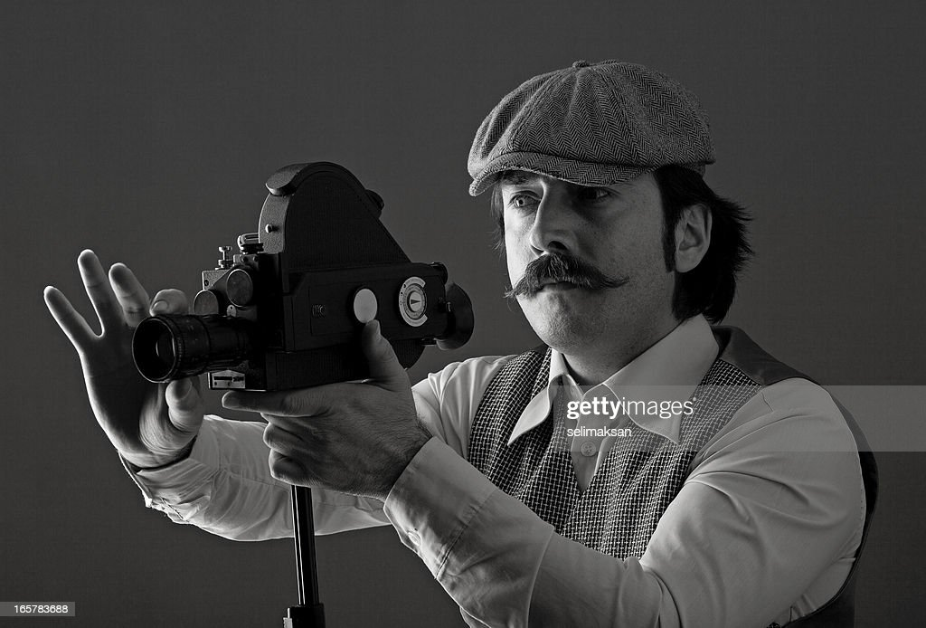 Portrait of film director behind camera