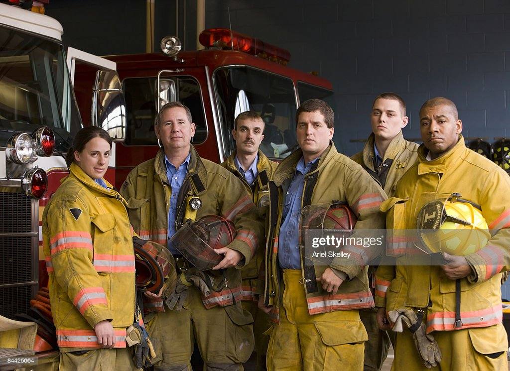 Portrait of Fire Fighters in Fire Station : Stock Photo