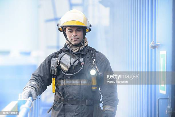 Portrait of firefighter in fire simulation training facility