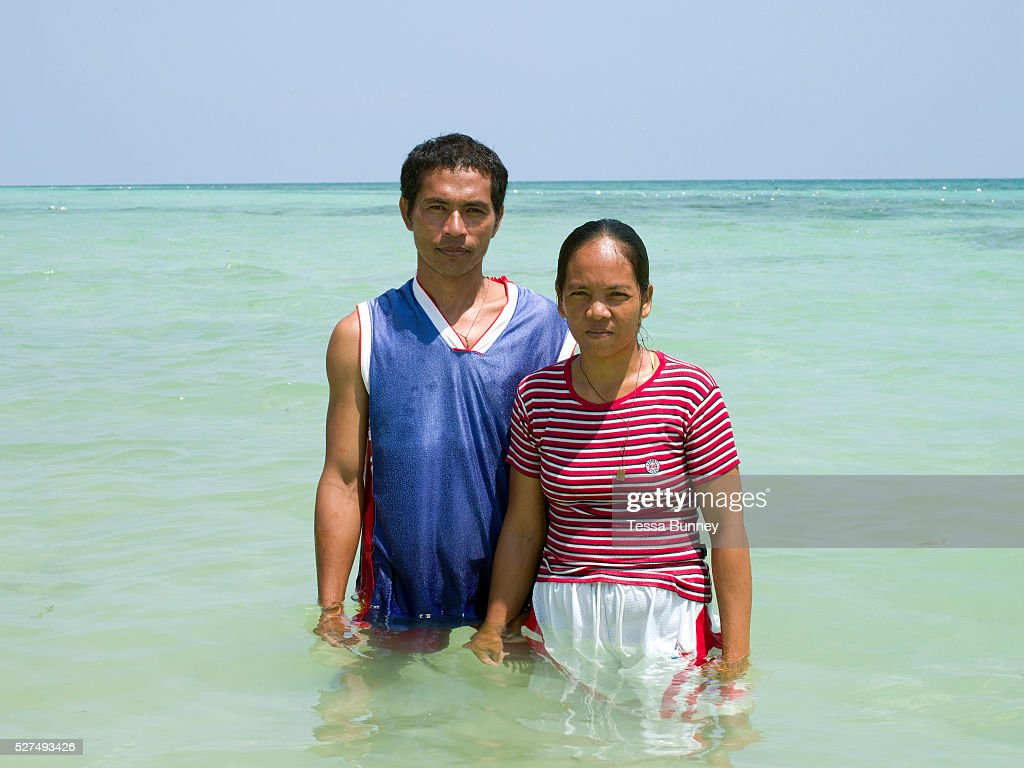 Portrait of fishermen and seaweed farmers Francisco I Yeliganio and Zosima Yeliganio in the sea Tamiao Bantayan Island The Philippines On November 6...