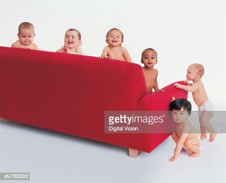 Portrait of Five Babies Around a Sofa