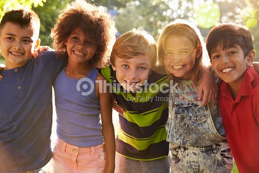 Portrait Of Five Children Having Fun Outdoors Together : Stock Photo
