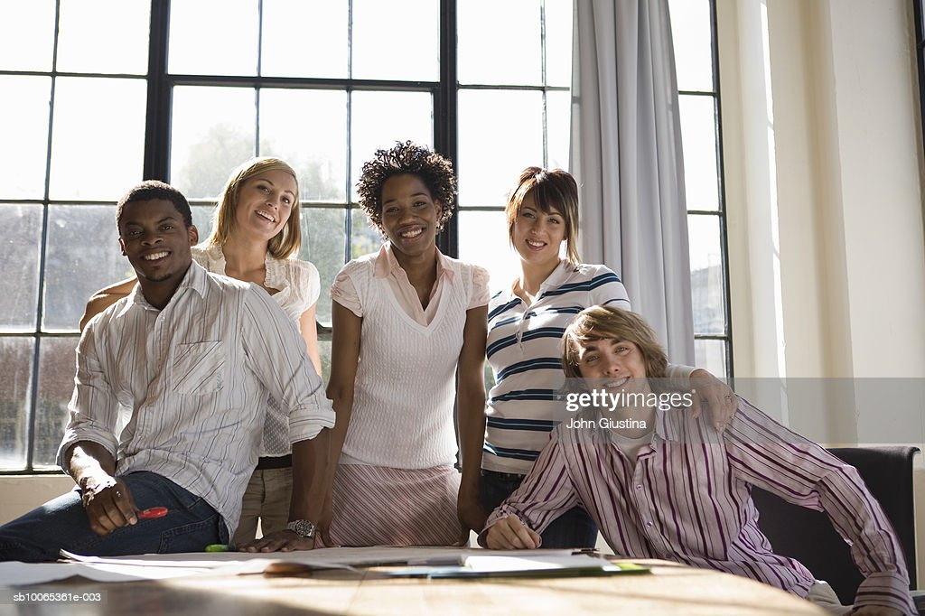 Portrait of five co-workers at desk : Stock Photo