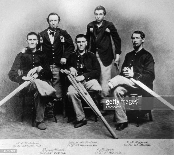 A portrait of five Union soldiers at the Armory Square Hospital Washington DC who have all lost limbs during the American Civil War 'AJ Hutchins Co...
