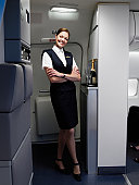 Portrait of flight attendant on airplane