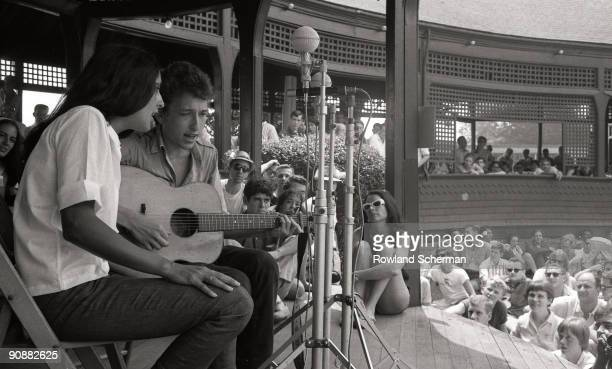 Portrait of folk musicians Joan Baez and Bob Dylan taken while they shared the stage during a duet at the Newport Folk Festival Rhode Island 1963...