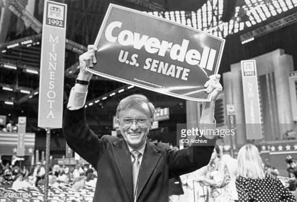 Portrait of Former Director of the Peace Corps Paul Douglas Coverdell DGa holding banner on August 1992 'n