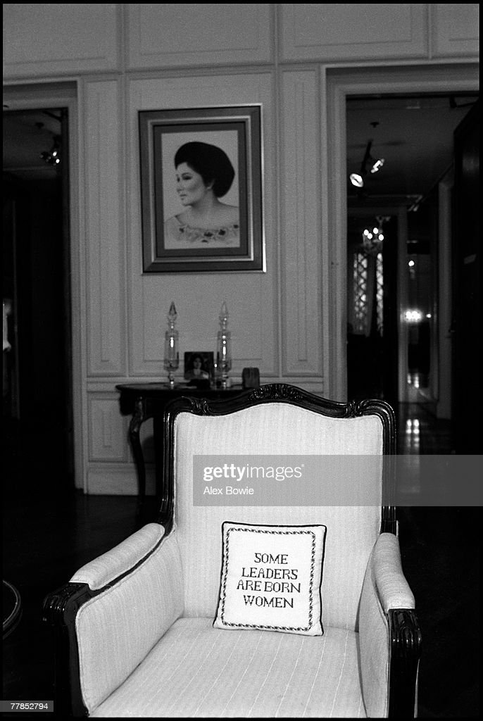 A portrait of former First lady of the Philippines, Imelda Marcos, along with a cushion with the embroidered text 'some leaders are born women' found in the Marcos family lounge at Malacanang Palace, Manila, 3rd March 1986. Marcos fled into exile with her husband after he was deposed in February 1986.