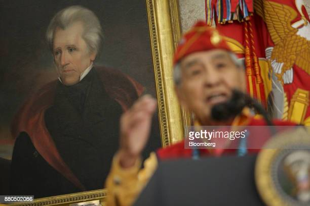 A portrait of former president Andrew Jackson is displayed as a Navajo World War II veteran speaks during an event honoring Native American 'Code...