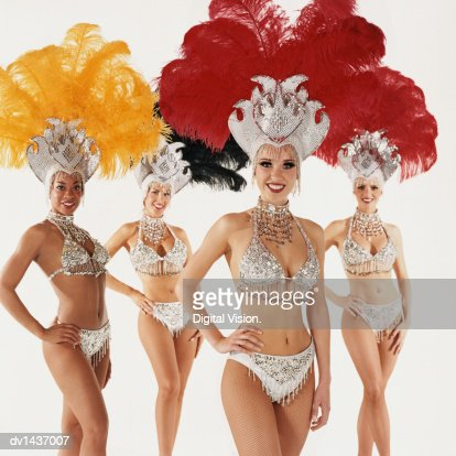 Portrait of Four Chorus Girls, Wearing Full Costume and Standing with Their Hands on Their Hips