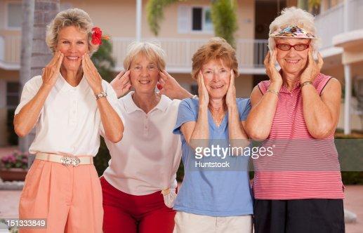 Portrait of four female friends wanting facelifts : Stock-Foto