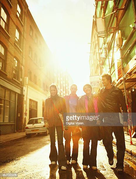 Portrait of Four Friends in a Sunny Street
